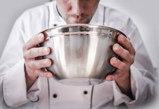 Food Preparation by Chef. Kitchen Chef Cooking Time. Caucasian Chef with Stainless Steel Bowl in Hands During Food Preparation royalty free stock photos