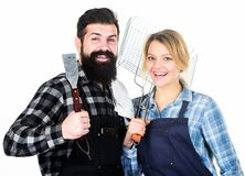 Food preparation. Family weekend. Man bearded hipster and girl. Preparation and culinary. Tools for roasting meat. Couple in love hold kitchen utensils. Picnic stock photo