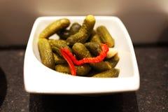 Food preparation pickled gherkins Stock Photo