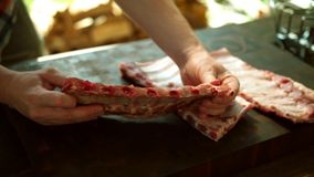 Food preparation, rack of pork ribs. Glazed, outdoor. royalty free stock photo