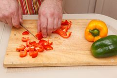 Sliced bell peppers. Food preparation: sliced bell peppers royalty free stock images