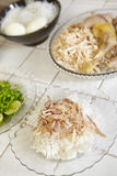 Food preparation. For soto, the treaditional Indonesian chicken soup. a plate with steamed rice and rice vermicille and shredded chicken Royalty Free Stock Images