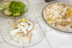 Food preparation. For soto, the treaditional Indonesian chicken soup. a plate with steamed rice and rice vermicille and shredded chicken Royalty Free Stock Photos