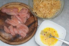 Food Preparing. Raw Chiken Breast Meat and Raw eggs with Homemade Pasta with Spices, s and herbs. Top view. Food Preparing. Raw Chiken Breast Meat and Raw eggs Stock Images