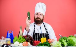 Food presentation. Vegetarian. Mature chef with beard. Healthy food cooking. Bearded man cook in kitchen, culinary royalty free stock photos