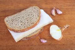 Food for the prevention and treatment of colds and influenza: br. Ead, fat, onion, garlic Royalty Free Stock Photo