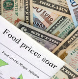 Food prices soar. Newspaper headlines. Global currency in the background Royalty Free Stock Photography