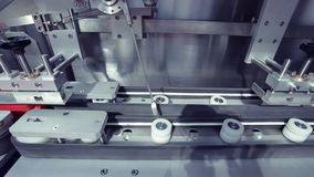 Food processing factory - bottle direction machine stock video