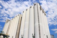 Food processing factory. Grain silos at a vegetable oil factory in France. Food production industry stock images