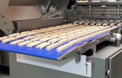 Food Processing Machine. Food Processing Machine Producing a Variety of Shapes Stock Photography