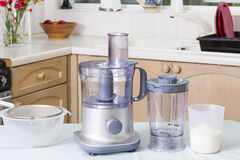 Food processor in kitchen. Domestic appliances (food processor) on kitchen table Royalty Free Stock Images