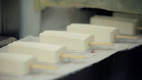 Food production line. Ice cream production line at food factory. Food industry. Food production line. Ice cream production line. Food factory. Close up of ice stock footage