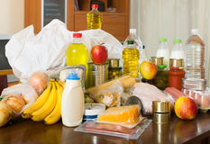 Food purchases on table in home Stock Photos