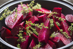 Food: Raw Beetroot and Thyme in a Tagine, ready to be stewed Royalty Free Stock Photo