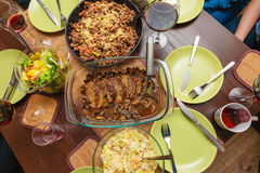 Food. Ready dinner on the table. Meal time. Food. Ready delicious dinner meat pasta and salad on the table. Meal time. Indoor royalty free stock photography