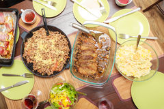 Food. Ready dinner on the table. Meal time. Food. Ready delicious dinner meat pasta and salad on the table. Meal time. Indoor royalty free stock photos