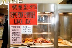 Food ready for lunch boxes in Ruby Rouge chinese restaurant in Montreal`s chinatown stock image