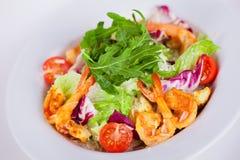 Food for the restaurant Caesar salad with shrimps Stock Photos