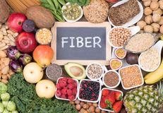 Food rich in fiber, top view. Various fruit, vegetables and grains rich in fiber, top view on wooden background royalty free stock image