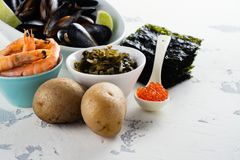 Food rich of iodine. Natural sources of iodine. Space for text royalty free stock photos