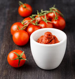 Ripe tomatoes and tomato paste Stock Photos