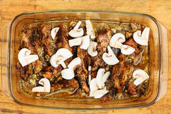 Food. Roasted chicken meat with mushrooms Stock Images