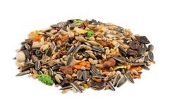 Food for rodents, a pile of cereals, seeds and components isolated on white background, side view. Food for rodents, a pile of cereals, seeds and components royalty free stock photo