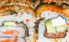 FOOD, ROLLS, SAIMON, CAVIAR. Salmon and caviar rolls in restaurant Stock Photography