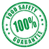 Food safety guarantee rubber stamp Stock Photography