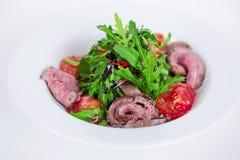 Food salad with smoked meat arugula and balsamic sauce Stock Image
