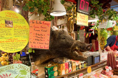 Food for sale at an indoor market in vancouver with a wild boar's head on display. A colorful array of products being sold at at granville island in british stock images