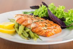 Broiled salmon. Food salmon dinner plate gourmet salad seafood royalty free stock images