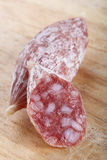 Food - sausage cocktail  mini salami. Food - sausage cocktail Air-dried  mini salami partly sliced on wood Stock Photography