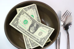 Food Savings. Dollar bill with spoon Stock Images