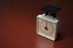 Food Scale. Standard food scale on red table shot at 3 quarter angle stock photo