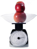 Food Scale. With apples in bowl Royalty Free Stock Images