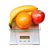 Food scale with fruits apple banana and orange isolated on white Royalty Free Stock Photos