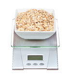Food scale with oatmeal bowl electronic and digital isolated Royalty Free Stock Image