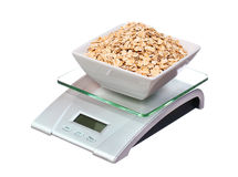 Food scale with oatmeal bowl electronic and digital isolated Stock Photos