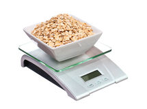 Food scale with oatmeal bowl electronic and digital isolated Royalty Free Stock Images