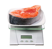 Food scale with salmon fish electronic and digital isolated Royalty Free Stock Photo