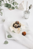 Food Scene of Chocolate Truffles in Small Pot on White Table Stock Photos