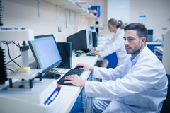Food scientist using technology to analyse cheese Royalty Free Stock Photography