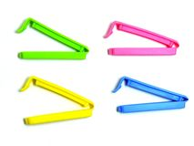 Food seal clips. Blue, green, pink and yellow food sealage clips Stock Photos