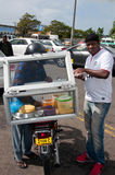Food seller in Flacq, Mauritius. FLACQ; MAURITIUS - JUNE 23: Mobile street seller selling food on JUNE 23, 2013 in FLAQC, MAURITIUS Stock Photos