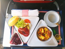 Food served on board of business class airplane on the table stock images