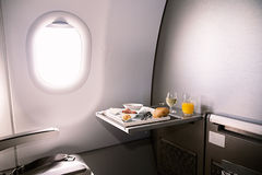 Food served on board of business class airplane on the table Stock Photo