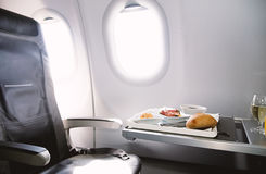 Food served on board of business class airplane on the table. Photo of Food served on board of business class airplane on the table royalty free stock photography