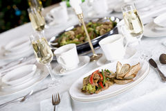 Food served on elegant table Royalty Free Stock Photo