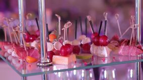 Buffet with snacks, Cocktail, snacks and alcohol at the buffet, drinks on the table, gourmet, indoors, close-up. Food served on the table , the Swedish table stock footage
